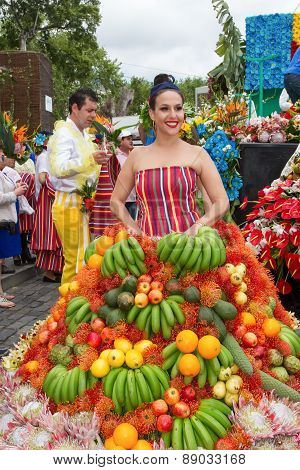 FUNCHAL MADEIRA - APRIL 20 2015: A young woman in a Fruits Costume in the Madeira Flower Festival 20