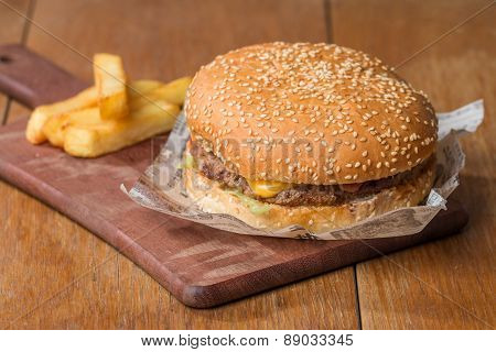 Delicious Burger On Paper And Fries
