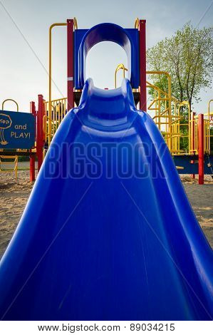 Blue Plastic Slide At Playground