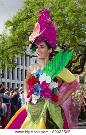 FUNCHAL MADEIRA - APRIL 20 2015: Young woman with flower headdress at the Madeira Flower Festival Fu