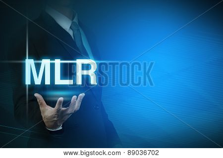 businessman with MLR word stand for Minimum Loan Rate on abstract background .bank interest
