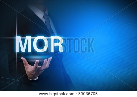 businessman with MOR word stand for Minimum Overdraft Rate on abstract background .bank interest