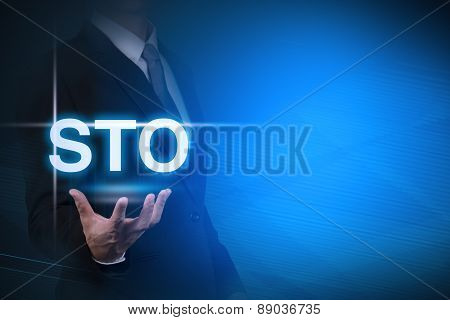 businessman with STO word stand for Standing Order automatic money transfer on abstract background .
