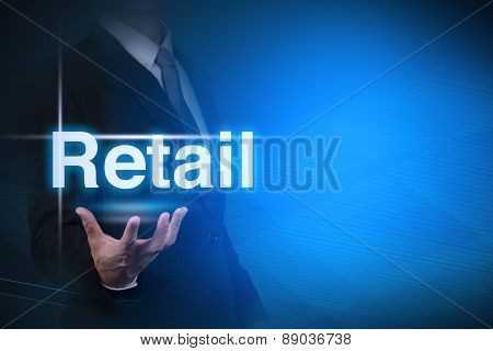 businessman with Retail word on abstract background .key for business