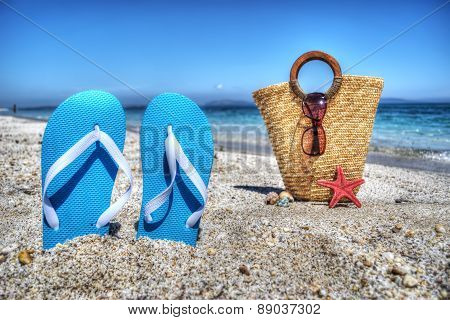 Blue Sandals And Straw Bag By The Shore