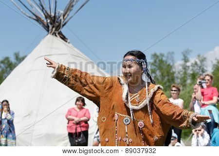 Girl In Clothing Aborigine Of Kamchatka Dancing On The Background Of Yaranga