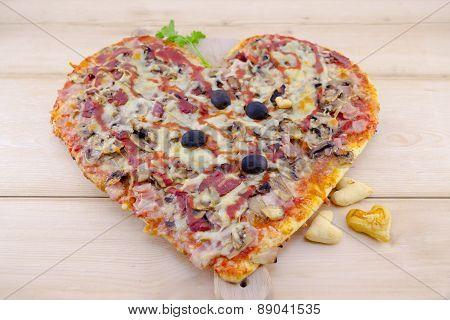 Heart Shaped Pizza On Wood
