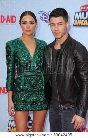 LOS ANGELES - APR 25:  Olivia Culpo, Nick Jonas at the Radio DIsney Music Awards 2015 at the Nokia Theater on April 25, 2015 in Los Angeles, CA