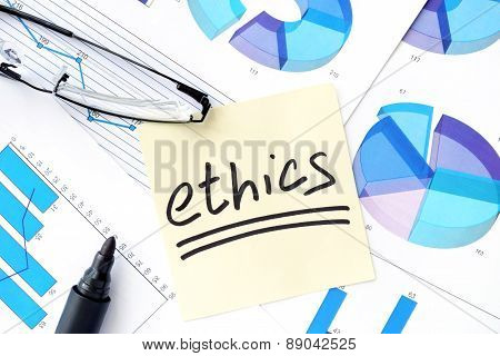 Papers with graphs, glasses and ethics business  concept.
