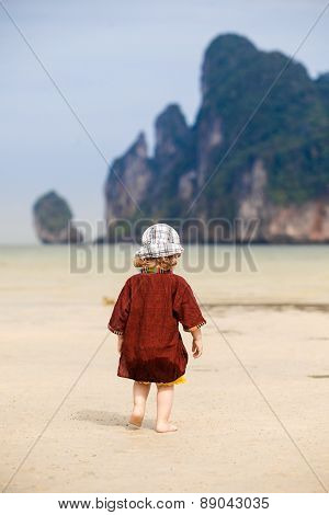 Child Walking On Fine Sand