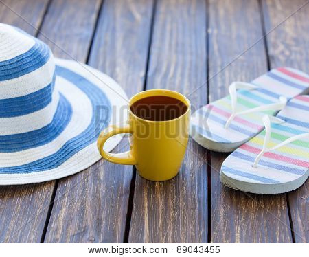 Cup Of Coffee And Hat With Flip Flops