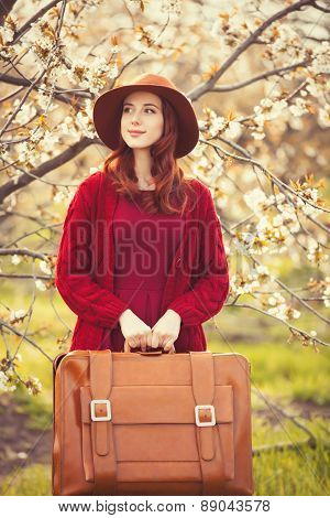 Women In Red Sweater And Hat With Suitcase