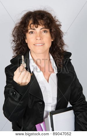 Happy Businesswoman Holding Keys For Customers