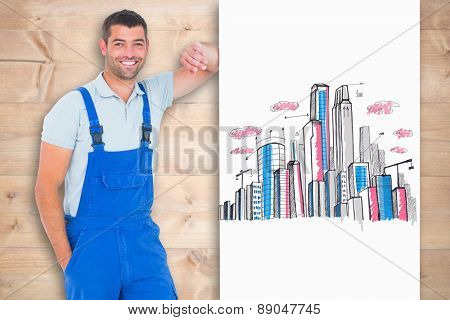 Happy repairman leaning on blank placard against bleached wooden planks background