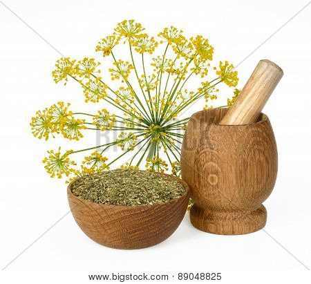 Dried Dill Crushed In A Wooden Bowl