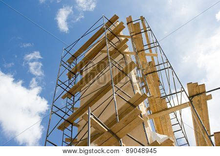 Industrial Construction: Isolated Metal Scaffold Against Blue Sky