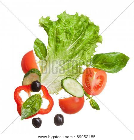 salad isolated in white - red tomatoes, pepper, basil, cucumber and olives, top view