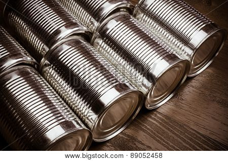 Close up of aluminum cans on wooden background
