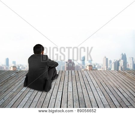 Rear View Businessman Hands Holding Knee Sitting With Urban Scene