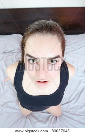 Young Woman Lying In Bed And Looking To Men's Genital