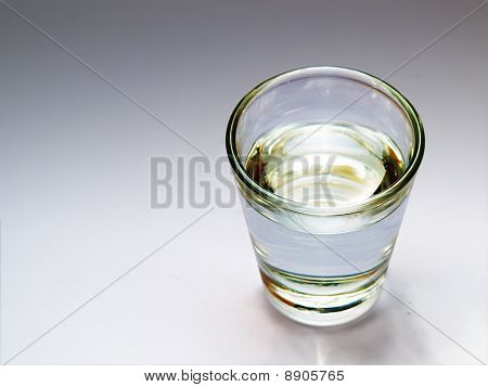 A glass with fresh water, soda, vodka, etc / close up