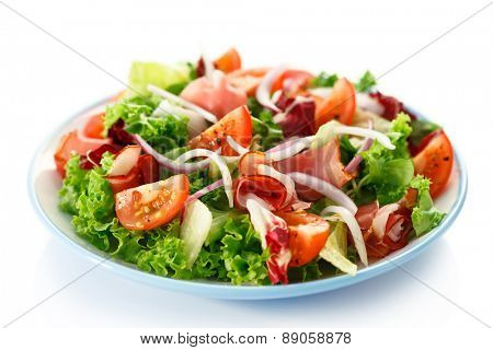 Smoked ham and vegetables on white background