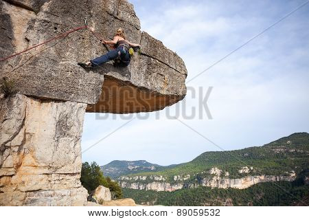 Young female climber on a cliff