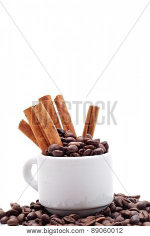 Coffee Seed and White Cup with Cinnamon