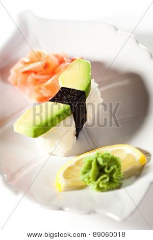 Japanese Cuisine -  Avocado Nigiri Sushi with Ginger and Wasabi