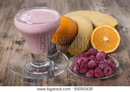 Smoothie Of Banana, Orange Juice , Frozen Raspberry   With Yogurt