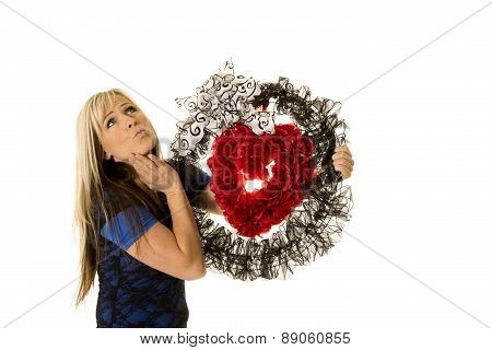 Woman Holding Heat Wreath Kiss