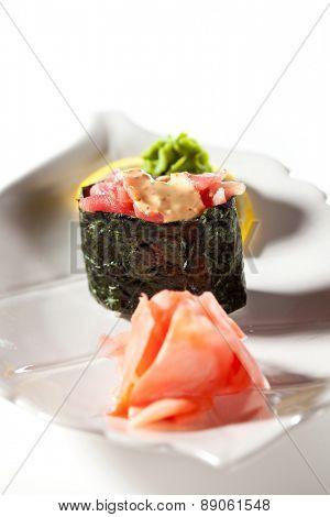 Spicy Tuna Gunkan Sushi. Garnished with Ginger and Wasabi