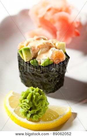 Spicy Salmon with Avocado Gunkan Sushi. Garnished with Ginger and Wasabi