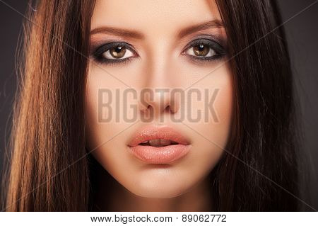 Beauty Fashion Model Girl with smoky eyes make-up, close-up studio shoot