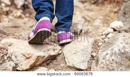 Cropped view of woman walking along trail