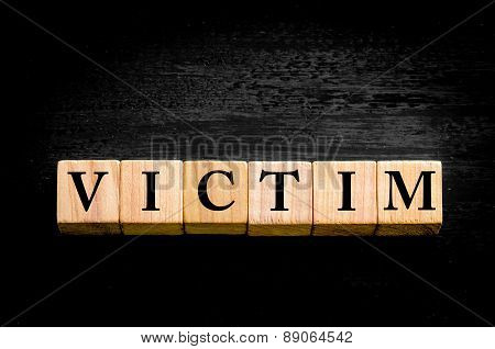 Word Victim Isolated On Black Background