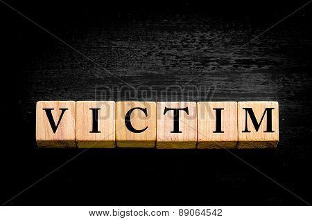 Word Victim Isolated On Black Background