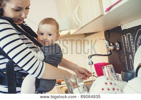 Mother washing up dishes