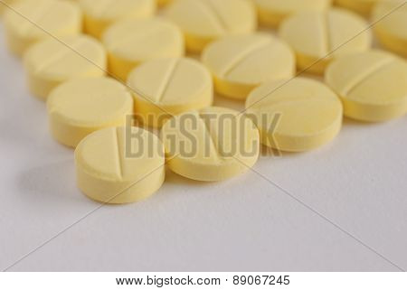 Heap Of Yellow  Round Medicine Tablet