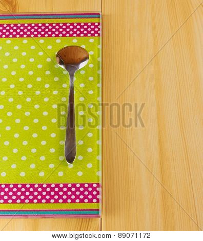 Teaspoon On Green Cutting Board