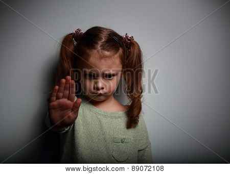 Kid Girl Showing Hand Signaling To Stop Violence And Pain And Looking Down