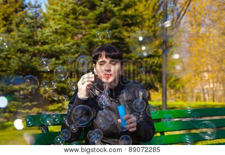 Young Beautiful Brunette Woman Blowing Bubbles