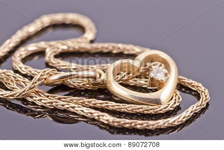Gold Chain With Pendant In The Shape Of A Heart