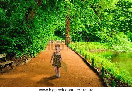 A Little Girl Runs To Meet.