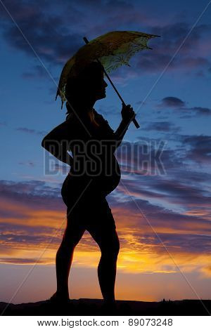 Silhouette Of A Woman Pregnant Holding An Umbrella