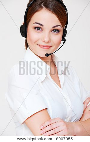 Friendly Telephone Operator Over Grey Background