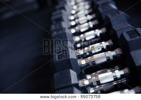 Closeup image of a dumbbells in fitness gym