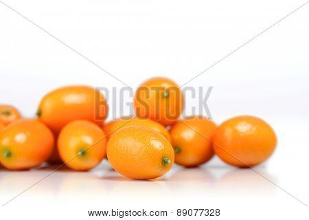 Kumquats on white background  - studio shot