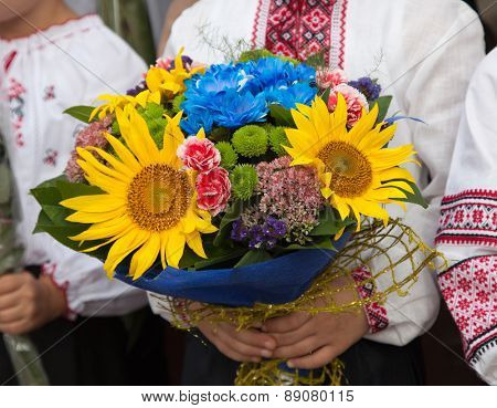 National traditions. Flowers in the hands of a child. Ukraine.
