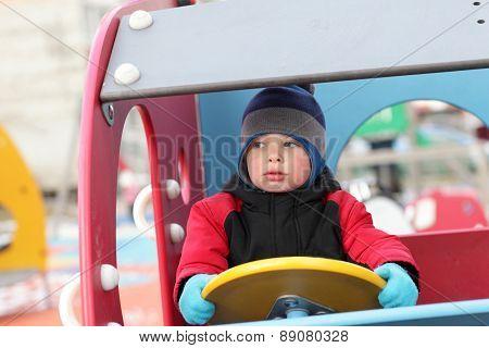 Boy Driving Wooden Car